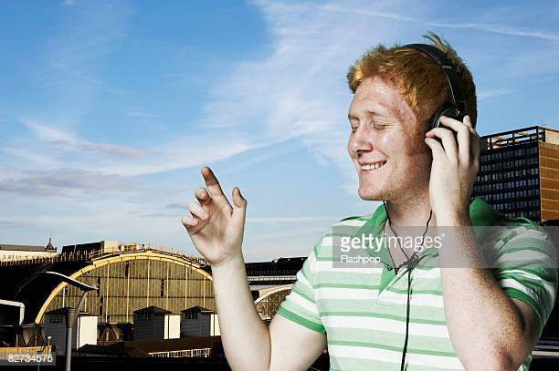 portrait of man listening to music - redhead stock pictures, royalty-free photos & images