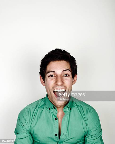 portrait of man looking happy - mouth open stock pictures, royalty-free photos & images