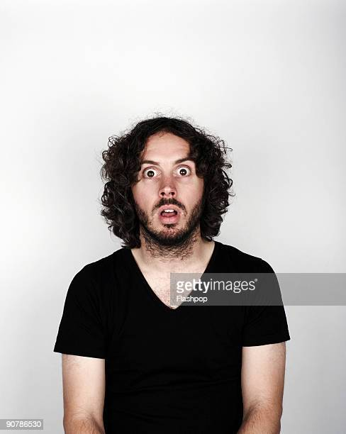 Portrait of man looking surprised