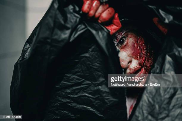 portrait of man lying down on bed - female torture stock pictures, royalty-free photos & images