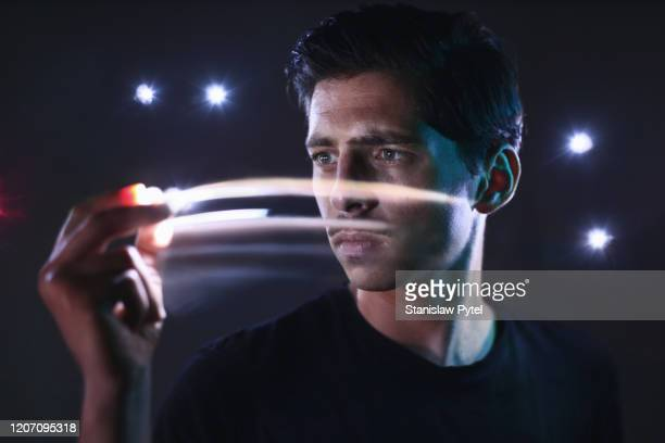 portrait of man moving lights in his hand - long exposure stock pictures, royalty-free photos & images