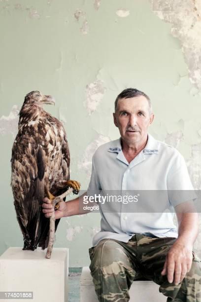 portrait of   man next to   stuffed bird