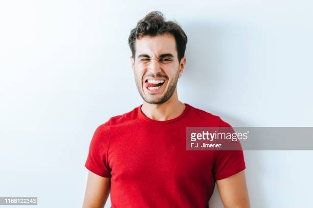 portrait of man on white wall - tongue stock pictures, royalty-free photos & images