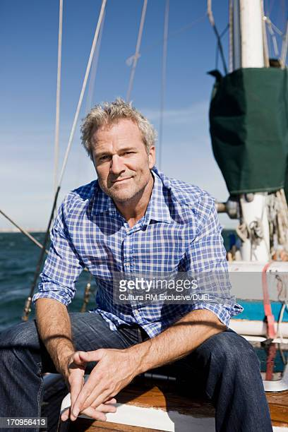 Portrait of man on yacht wearing checked shirt