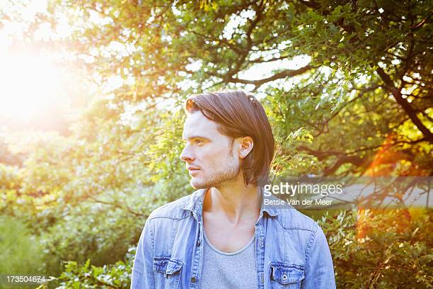 Portrait of man outdoors in woods.