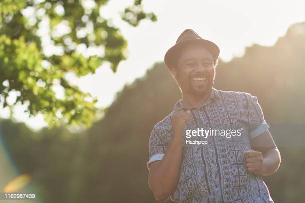 portrait of man outdoors - carefree stock pictures, royalty-free photos & images