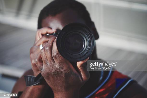 portrait of man photographing outdoors - professional occupation stock pictures, royalty-free photos & images