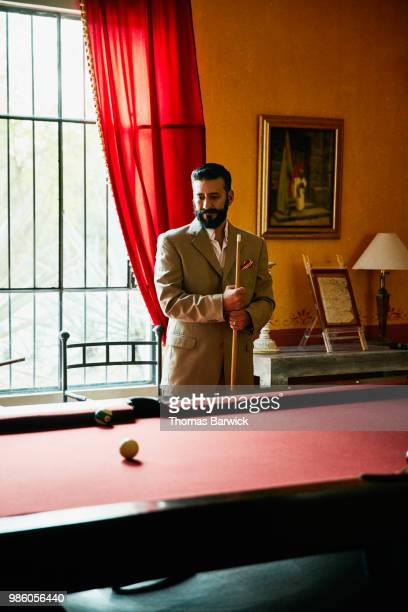 Portrait of man playing pool