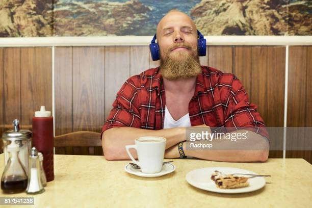 portrait of man relaxing in a cafe - fully unbuttoned stock pictures, royalty-free photos & images