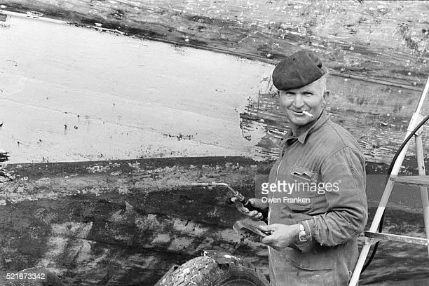 Portrait of Man Repairing Boat