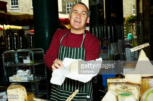 Portrait of man selling fresh cheese