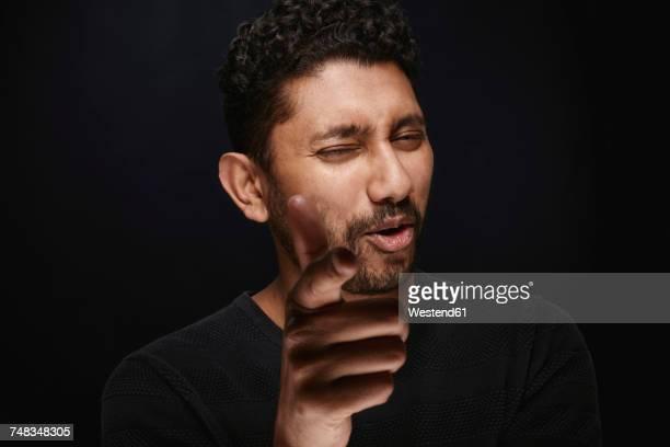 Portrait of man shooting viewer