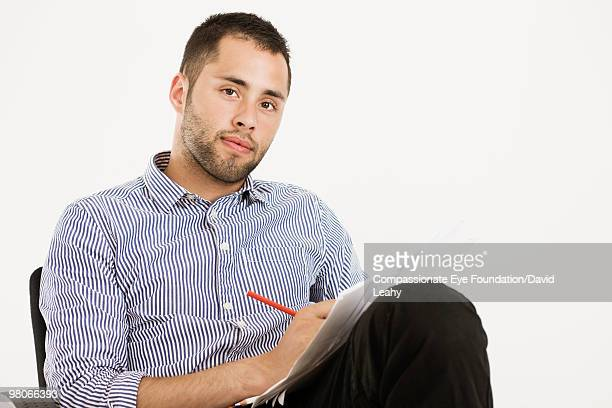 "portrait of man sitting and writing - ""compassionate eye"" stock pictures, royalty-free photos & images"