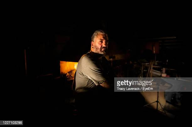 portrait of man sitting in the dark - sculpture stock pictures, royalty-free photos & images