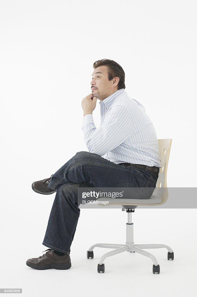 Man Sitting Cross Legged Side View Portrait Of Man Sittin...