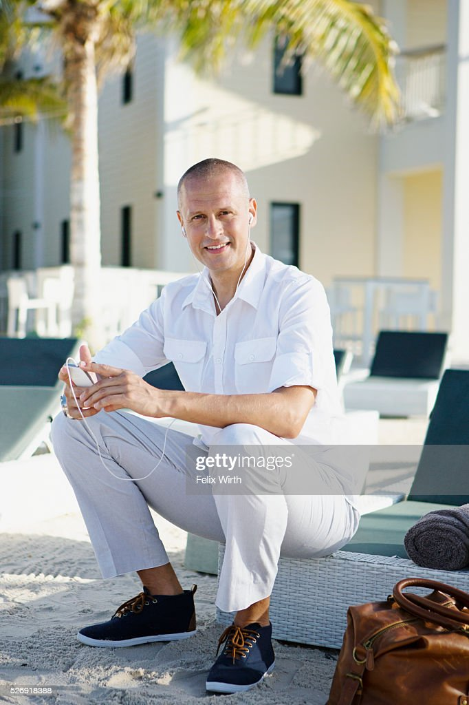 Portrait of man sitting on deck chair : Foto stock