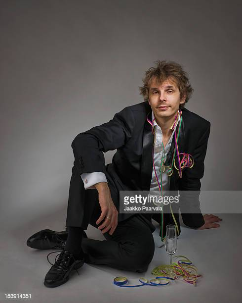 portrait of man sitting - after party man stock pictures, royalty-free photos & images