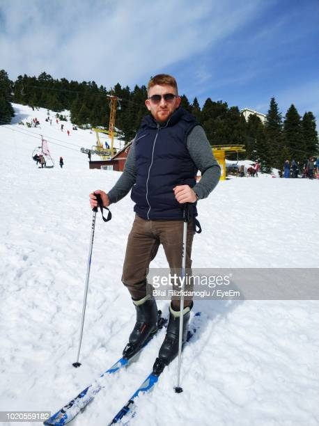 Portrait Of Man Skiing On Slope