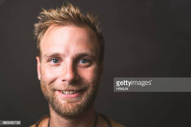 portrait of man smiling against blackboard - creative director stock pictures, royalty-free photos & images