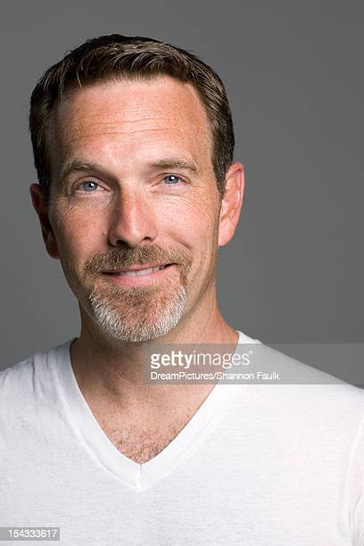 portrait of man smiling at camera - goatee stock pictures, royalty-free photos & images