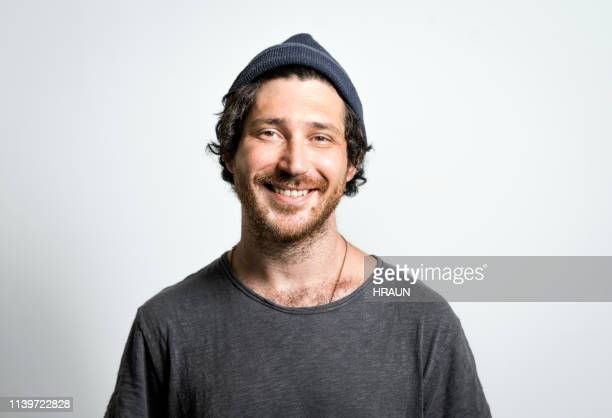 portrait of man smiling on gray background - mid adult men stock pictures, royalty-free photos & images
