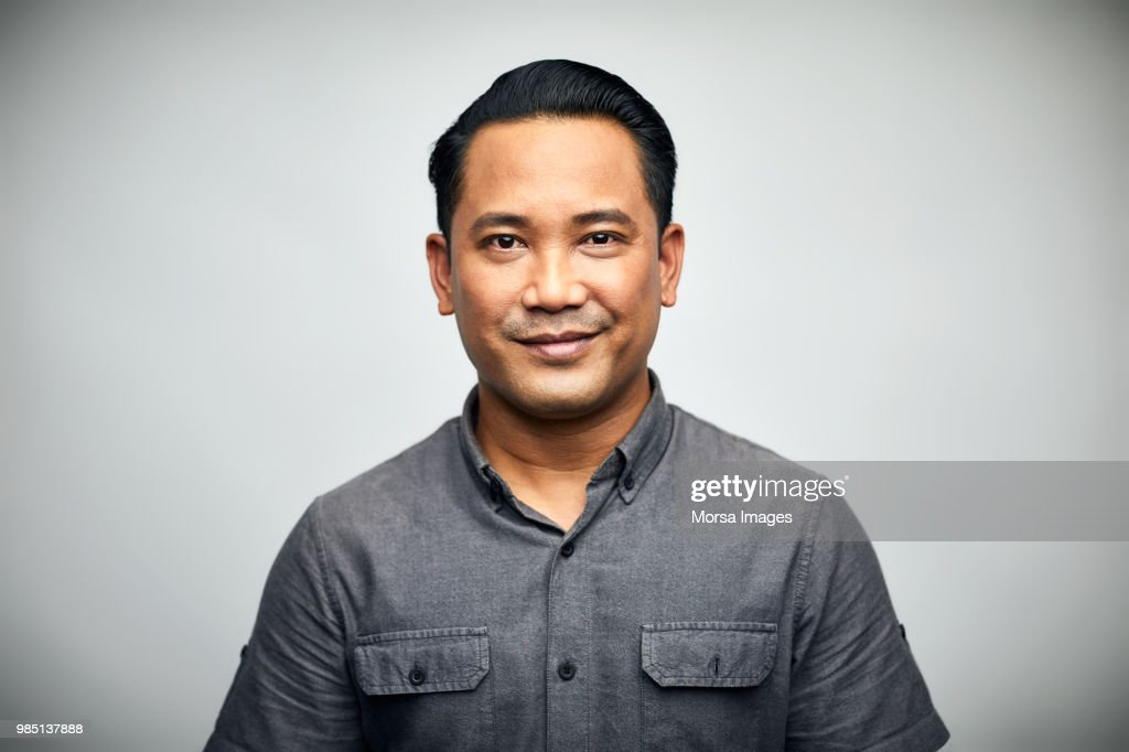 Portrait of man smiling over white background : Stock Photo