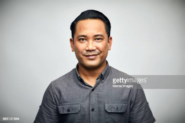 portrait of man smiling over white background - asia stock pictures, royalty-free photos & images