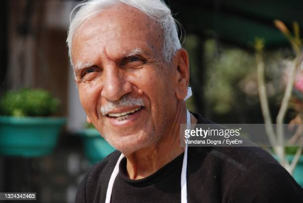 portrait of man smiling - white hair stock pictures, royalty-free photos & images