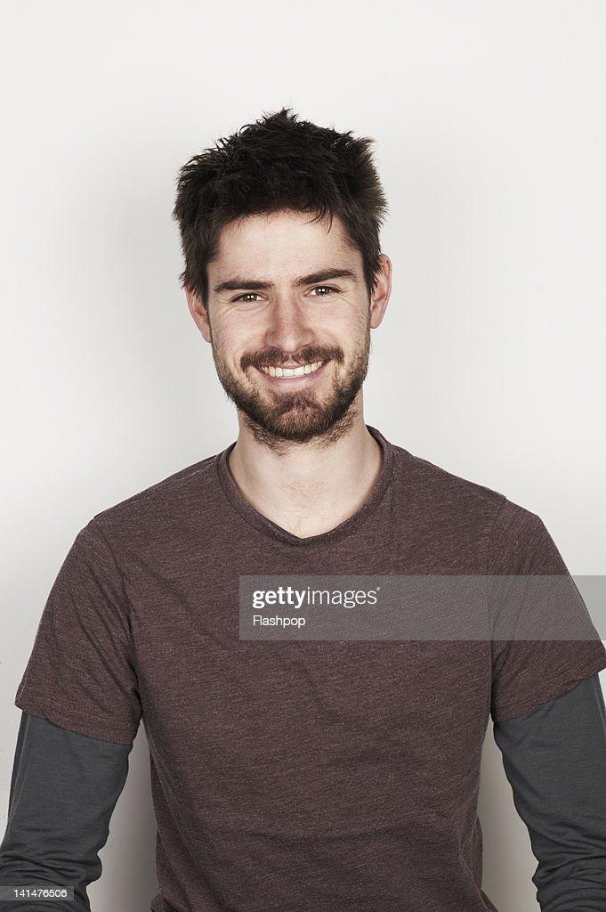 Portrait of man smiling : Bildbanksbilder