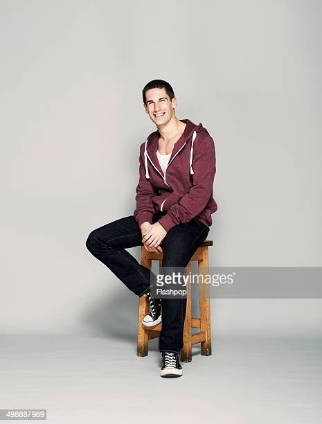 portrait of man smiling - sitting foto e immagini stock