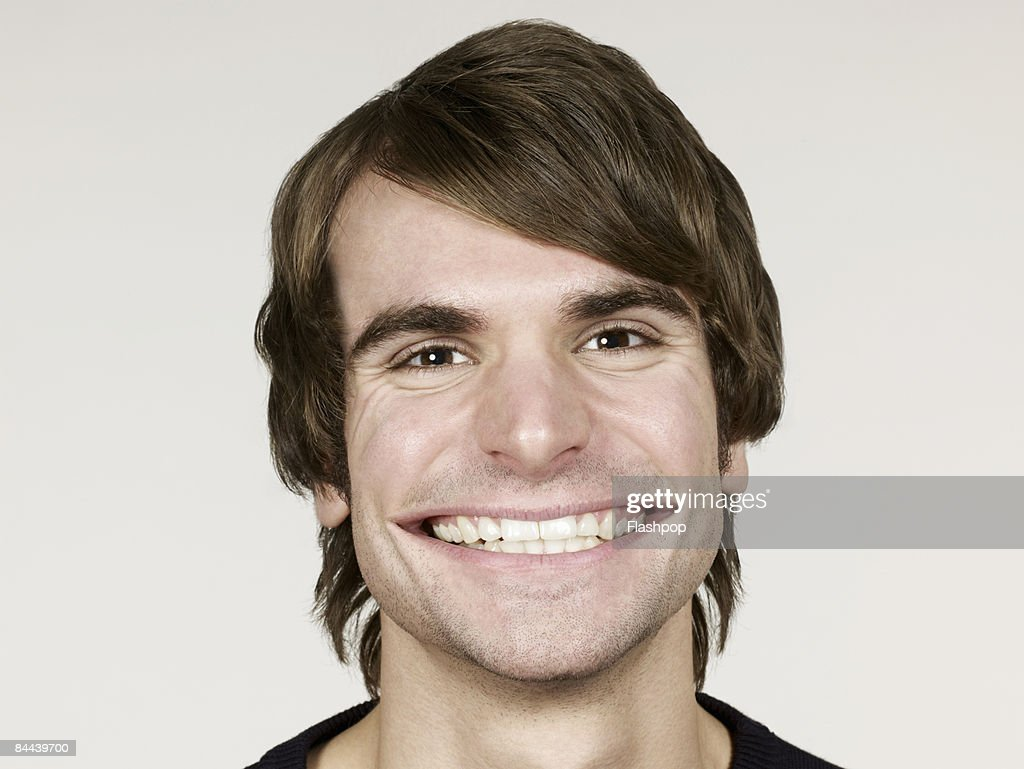 Portrait of man smiling with big mouth : ストックフォト