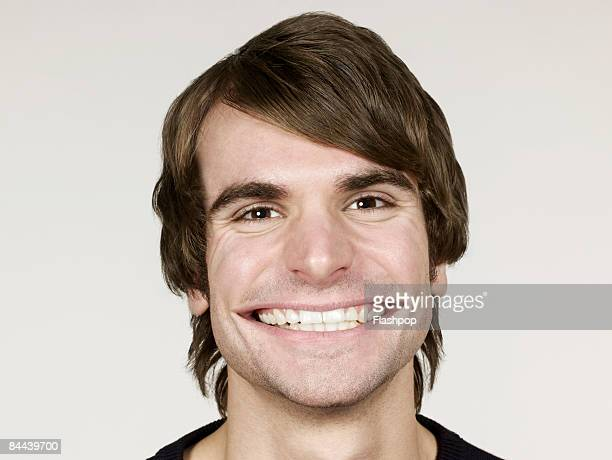 portrait of man smiling with big mouth - excess stock pictures, royalty-free photos & images