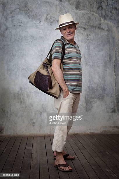 Portrait of man smiling with hand made bag