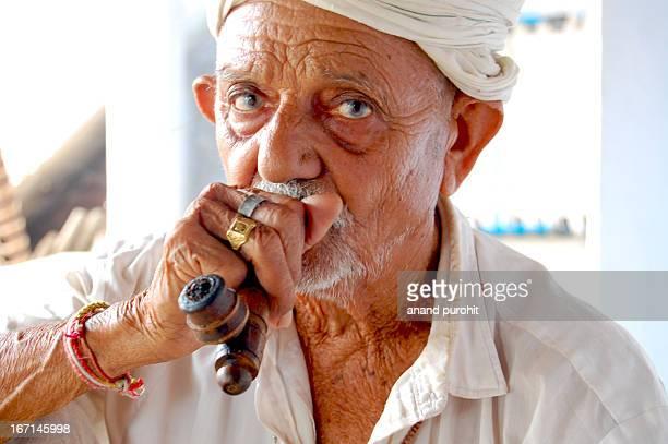 Portrait of Man Smoking Pipe, Gujarat, India taken at Village: Bakrol near Ahmedabad