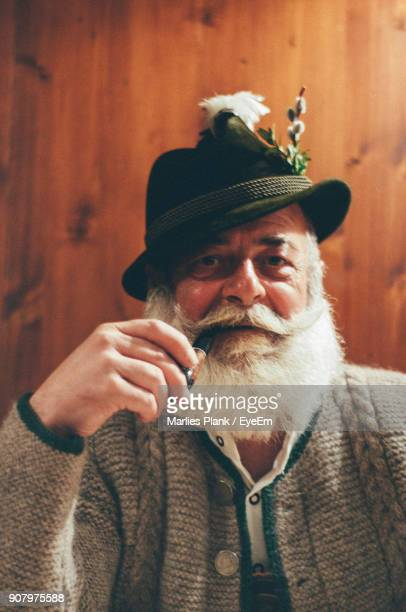 portrait of man smoking pipe - traditional clothing stock pictures, royalty-free photos & images