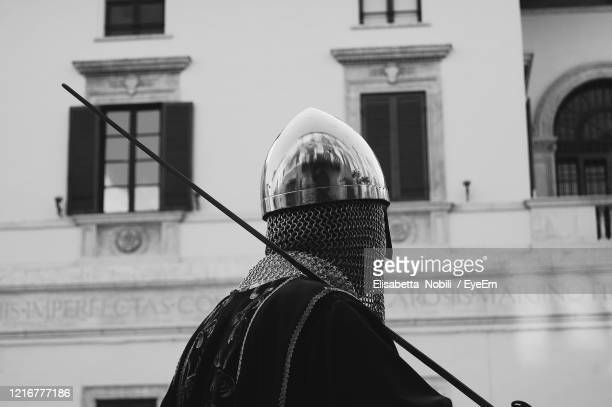 portrait of man standing against building in city - obscured face stock pictures, royalty-free photos & images
