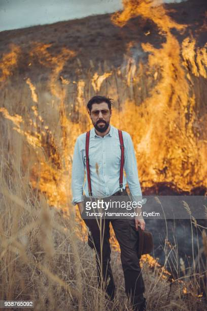 Portrait Of Man Standing Against Forest Fire