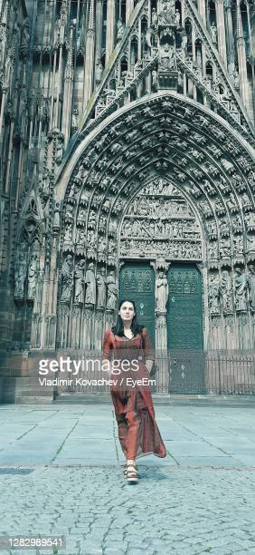 portrait of man standing against temple outside building - strasbourg stock pictures, royalty-free photos & images