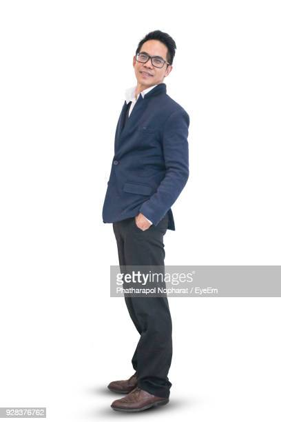 portrait of man standing against white background - blazer jacket stock pictures, royalty-free photos & images