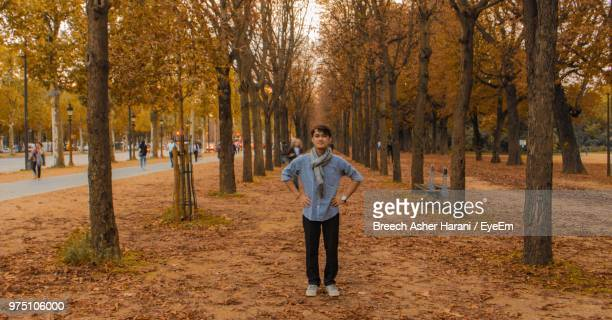 Portrait Of Man Standing Amidst Trees In Park