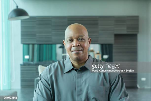 portrait of man standing at home - webcam stock pictures, royalty-free photos & images