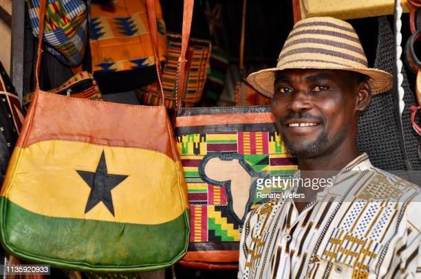 portrait of man standing at market stall - ghana africa fotografías e imágenes de stock