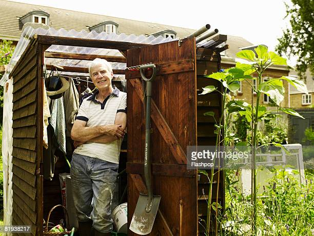 Portrait of man standing in his allotment shed