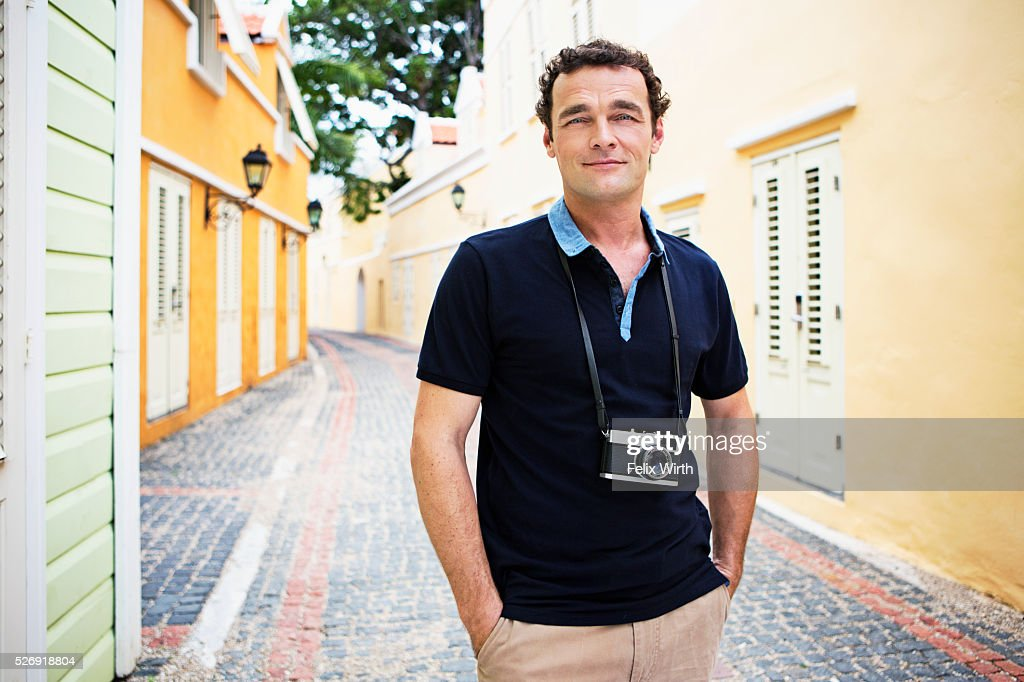 Portrait of man standing on narrow street : Photo
