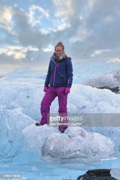 portrait of man standing on snow - arctic stock pictures, royalty-free photos & images