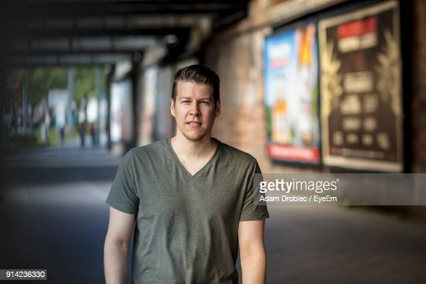 portrait of man standing outdoors - v neck stock photos and pictures