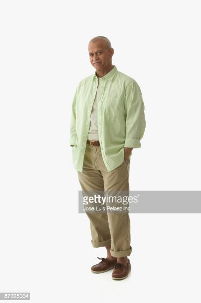 Portrait of man standing with hands in pockets