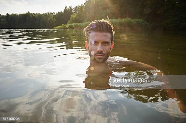 Portrait of man swimming in lake