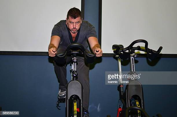 Portrait of man training on an exercise bike