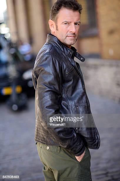 Portrait of man wearing black leather jacket